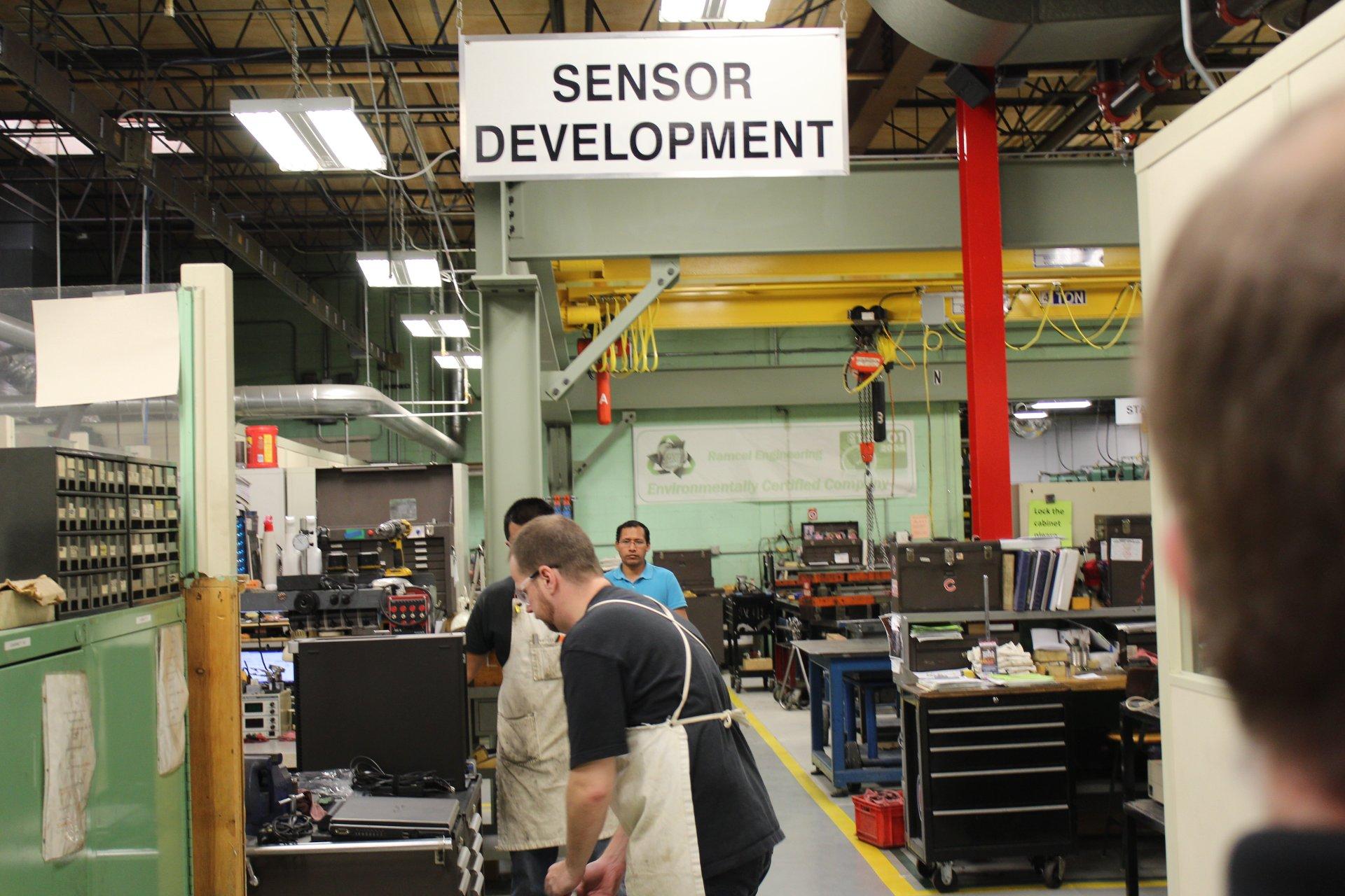 Photo of Ramcel engineers working on die sensors