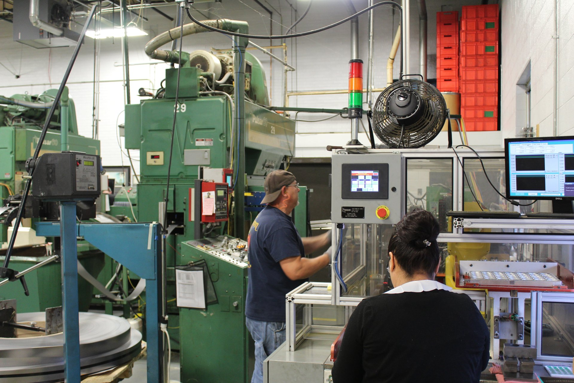 Photo of engineers cusom metal stamping