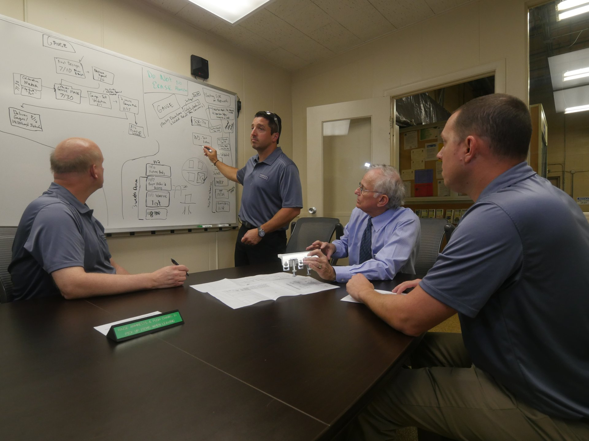 A photo of Ramcel engineers working collaboratively